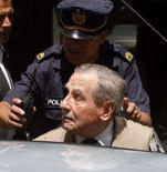 <p>Um juiz uruguaio enviou nesta segunda-feira à prisão o ex-ditador Gregorio Alvarez, acusado de participar do sequestro e desaparecimento de várias pessoas durante o regime militar (1973-85). Foto em Montevidéu, 5 de dezembro. Photo by Andres Stapff</p>