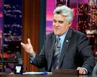 "<p>Jay Leno during a taping of ""The Tonight Show with Jay Leno"" in a file photo. Late-night TV comedians Leno and Conan O'Brien said on Monday they will resume taping their shows on January 2, and cross picket lines if necessary, after nearly two months off the air in support of striking film and television writers. REUTERS/Fred Prouser</p>"