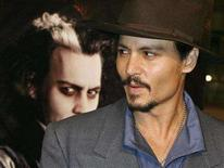 "<p>Johnny Depp poses next to a poster featuring him in character at a special screening of the DreamWorks Pictures film ""Sweeney Todd: The Demon Barber of Fleet Street"" at Paramount Studios in Hollywood, December 5, 2007. The ""Pirates of the Caribbean"" star who turns menacing in his new role as murderous barber Sweeney Todd, has been named the best celebrity autograph signer for the third year running. REUTERS/Fred Prouser</p>"