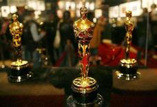 <p>The actual Oscar statues to be presented to winners are displayed in cases near the Kodak Theatre, site of the 78th annual Academy Awards, in Hollywood March 3, 2006. The Academy Awards presentation is still two months away but the world's top film awards ceremony found itself embroiled on Tuesday in the worst Hollywood labor clash in two decades. REUTERS/Gary Hershorn</p>