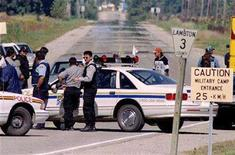 <p>Members of the Kettle and Stoney Point Indian Reserve block the road in front of the native occupied Camp Ipperwash on September 11, 1995. REUTERS/Peter Jones</p>