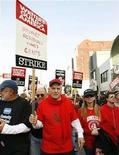 <p>Director Garry Marshall (C) walks with striking members of the Writers Guild of America, West during a rally in Hollywood, November 20, 2007. REUTERS/Mario Anzuoni</p>