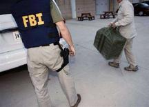 <p>Un agente dell'Fbi REUTERS/Kevin Wolf/Pool</p>
