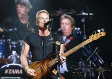 <p>Lead singer and bassist Sting (front), guitarist Andy Summers and drummer Stewart Copeland (both in the video screen) perform at the Puerto Rico Coliseum The Police Reunion tour in San Juan, Puerto Rico, December 11, 2007. REUTERS/Ana Martinez</p>