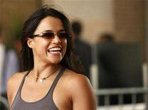 <p>Actress Michelle Rodriguez smiles during the 32nd Toronto International Film Festival in Toronto September 8, 2007. Rodriguez began a 180-day jail term in Los Angeles on Sunday for probation violation, the second Hollywood celebrity after Kiefer Sutherland to face a Christmas incarceration. REUTERS/Mario Anzuoni</p>