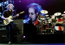 <p>Rush guitarist Alex Lifeson (L) and drummer Neil Peart perform in front of a video image of singer/bassist Geddy Lee in this September 21, 2002 file photo taken in Las Vegas, Nevada . Rush will return to the road for a 40-plus-date outing next April in Puerto Rico. REUTERS/Ethan Miller</p>