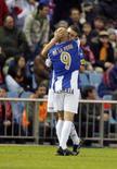 <p>Luis Garcia (à direita), do Espanyol, comemora gol com Ivan de la Peña contra o Atlético de Madri. O Espanyol virou o jogo fora de casa e venceu por 2 x 1 neste domingo. O resultado coloca o time na terceira colocação no campeonato espanhol. Photo by Andrea Comas</p>