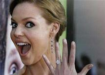 "<p>In this file photo cast member Katherine Heigl displays her engagement ring from fiance musician Josh Kelley at the premiere of ""Knocked Up"" in Los Angeles, California May 21, 2007. Heigl, an Emmy-winning star of medical drama ""Grey's Anatomy,"" married her musician boyfriend in Utah on Sunday, US Weekly magazine reported on its Web site. REUTERS/Fred Prouser</p>"