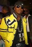 <p>Rap artist Yung Joc arrives at the 2007 MTV Video Music Awards in Las Vegas September 9, 2007. A Cleveland judge scolded rapper Yung Joc for being late to court on Wednesday but allowed him to remain free on bond on a charge of having a gun in his carry-on bag at the city's airport, authorities said. REUTERS/Mike Blake</p>
