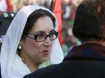 <p>Pakistani opposition leader Benazir Bhutto arrives to address an election rally in Rawalpindi December 27, 2007. Bhutto was assassinated on Thursday as she left an election rally in the city of Rawalpindi, putting January 8 polls in doubt and sparking anger in her native Sindh province. REUTERS/Mian Khursheed</p>