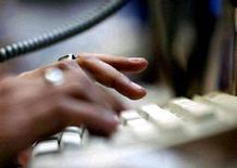 <p>Undated file photo shows a person at their computer. REUTERS/Sherwin Crasto</p>