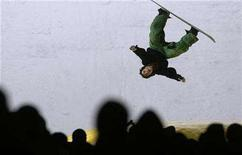 """<p>A man performs as part of the """"Big Air Back"""" show a day before the snowboard FIS World cup competition in Bulgarian capital Sofia December 21, 2007. Skiing purists are grumbling this year as they brace for an influx of snowboarders at Taos Ski Valley, New Mexico, one of the last ski-only holdouts in a culture war between the two pursuits. REUTERS/Nikolay Doychinov</p>"""
