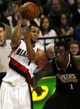 <p>Portland bate o Philadelphia em 13a vitória seguida na NBA. O Portland Trail Blazers bateu no domingo o Philadelphia 76ers por 97 a 72 e chegou a 13 vitórias consecutivas na NBA. 30 de dezembro. Photo by Steve Dipaola</p>