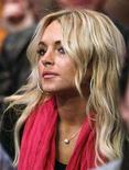 <p>Actress Lindsay Lohan watches the Los Angeles Lakers play the Seattle Supersonics in their NBA basketball game in Los Angeles November 27, 2007. REUTERS/Lucy Nicholson</p>