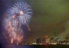 <p>New Years Eve fireworks in Toronto during Millennium celebrations, January 1. Canadians are bubbling over with optimism for 2008, although they are somewhat sobered by prospects for the rest of the world and the environment, according to a new poll. 	 REUTERS/Andrew Wallace</p>