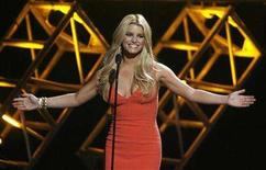 "<p>Singer Jessica Simpson is shown on stage introducing a performer at the taping of Country Music Television's special ""CMT Giants"" honoring Hank Williams, Jr. in Los Angeles October 25, 2007. Simpson is in the early stages of recording a country album in Nashville, a project slated for a 2008 release via Columbia Records. REUTERS/Fred Prouser</p>"