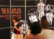 <p>A billboard commemorating the 40th anniversary of the Beatles in Tokyo, in a 2006 photo. Forty years and more after the Beatles changed rock music forever, their songs have truly arrived in the 21st century as part of the rap/hip-hop art form -- with the express permission of their publishers. REUTERS/Toru Hanai</p>