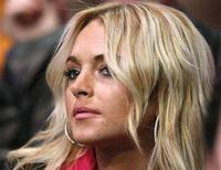 <p>Lindsay Lohan watches the Los Angeles Lakers play the Seattle Supersonics in their NBA basketball game in Los Angeles, November 27, 2007. Lohan fell off the sobriety wagon on New Year's Eve, her lawyer said on Thursday, ending a year that saw the star check into rehab several times and land in jail for drunken driving and cocaine possession. REUTERS/Lucy Nicholson</p>