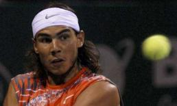 <p>O espanhol Rafael Nadal devolve bola durante semifinal no Aberto de Chennai. O tenista número 2 do mundo sofreu uma retumbante derrota neste domingo para o russo Mikhail Youzhny, na final do torneio na Índia. Photo by Babu</p>