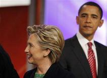 <p>Presidential candidates U.S. Senator Hillary Clinton and U.S. Senator Barak Obama meet onstage between back to back Republican and Democratic debates at Saint Anselm College in Manchester, New Hampshire January 5, 2008. REUTERS/Brian Snyder</p>