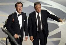 <p>Jon Stewart (R) and Stephen Colbert pictured at the Emmy Awards in Los Angeles, September 16, 2007. REUTERS/Mike Blake</p>