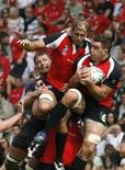 <p>Wales' Ian Gough (L) fights for the ball with Canada's Luke Tait (C) and Jamie Cudmore (R) during their Group B Rugby World Cup match at the La Beaujoire stadium in Nantes, western France, September 9, 2007. Cudmore will miss Clermont's last two Heineken Cup pool matches after being suspended for four weeks for punching a London Wasps player last month. REUTERS/Pascal Rossignol</p>