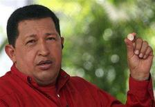 <p>Venezuela's President Hugo Chavez holds a coin while speaks during his weekly broadcast 'Alo Presidente', outside Caracas January 6, 2008. REUTERS/Miraflores Palace/Handout</p>