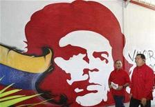 "<p>Venezuela's President Hugo Chavez (R) walks next to Miranda's state governor Diosdado Cabello in front of a mural of revolutionary icon Ernesto 'Che' Guevara during his weekly broadcast 'Alo Presidente', outside Caracas January 6, 2008. The Venezuelan government believes it has found an answer to what Chavez calls the ""dictatorship of Hollywood."" REUTERS/Miraflores Palace/Handout</p>"