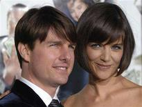 "<p>Cast member Katie Holmes (R) and husband Tom Cruise attend the premiere of the film ""Mad Money"" in Los Angeles January 9, 2008. A computer technician involved in a bid to extort $1.3 million from Cruise for copies of the actor's stolen wedding photographs was sentenced on Thursday to two years probation. REUTERS/Phil McCarten</p>"