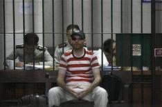 <p>Suspected Canadian paedophile Christopher Paul Neil waits inside the Bangkok Criminal Court's detention cell to be transferred to Klong Prem prison in Bangkok October 20, 2007. REUTERS/Sukree Sukplang</p>