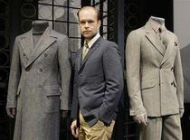 <p>Swedish designer Lars Nilsson poses between two creations of Gianfranco Ferre's Fall/Winter 2008/09 men's collection during Milan Fashion Week January 13, 2008. REUTERS/Alessandro Garofalo</p>