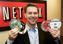 <p>Reed Hastings, CEO of Netflix Inc., a online DVD-rental service, holds several DVD's as he poses at the Netflix offices in Beverly Hills, California December 8, 2005. REUTERS/Fred Prouser</p>