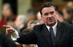 <p>Canada's Finance Minister Jim Flaherty stands to speak in the House of Commons on Parliament Hill in Ottawa November 27, 2007. REUTERS/Chris Wattie</p>