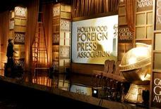 <p>A crew member works on stage in front of the set for the 65th annual Golden Globe Awards news conference at the Beverly Hilton hotel in Beverly Hills, January 13, 2008. REUTERS/Fred Prouser</p>