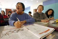 <p>63-year-old Beijing resident Zhi Lihong (L), learns English at an Olympic Community English Class for the elderly at a community center in Beijing in this December 20, 2007 file photo. The classes are all part of Beijing's effort to get its population to speak English to welcome the millions of foreigners expected to flood to the city in this Olympic year. REUTERS/Jason Lee</p>