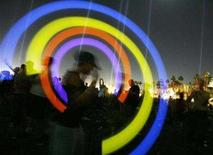 <p>A fan swings fluorescent sticks during the Tiesto performance at the Coachella Music Festival in Indio, California April 28, 2007. The promoters of the annual Coachella music festival in southern California are planning a New York-area version this summer, sources say. REUTERS/Mario Anzuoni</p>
