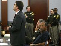 <p>O.J. Simpson, former football great, listens as his attorney Yale Galanter (L) addresses the judge as he appeared in court for violating terms of his bail in Clark County District Court in Las Vegas January 16, 2008. Simpson's trial is scheduled for April 7. REUTERS/Rick Wilking</p>