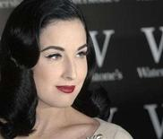 "<p>Dita Von Teese poses during a photcall to promote her new book ""Burlesque and the Art of Teese"" in London November 22, 2007. Teese will appear at Vienna's Opera Ball on January 31, the latest guest to ruffle the annual highlight of staid Austrian high society. REUTERS/Anthony Harvey</p>"