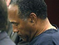 <p>O.J. Simpson, former football great, appears in court for violating terms of his bail in Clark County District Court in Las Vegas January 16, 2008. REUTERS/Rick Wilking</p>
