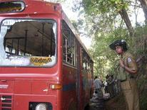 <p>A policeman stands guard near the bus damaged by a roadside explosion in Moneragala January 16, 2008. A roadside bomb ripped through a Sri Lankan bus killing 26 people and wounding dozens on Wednesday, officials said, as a six-year ceasefire between the government and Tamil Tiger rebels officially expired. Picture taken January 16, 2008. REUTERS/Stringer</p>