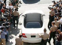 <p>Media surround a car driven by Britney Spears outside Los Angeles Superior Court, October 11, 2007. Four photographers were arrested for reckless driving after a late night car chase of Spears on the outskirts of Los Angeles, police said on Thursday. REUTERS/Fred Prouser</p>