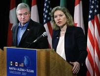 <p>Minister of International Trade David Emerson (L) listens as United States Trade Representative Ambassador Susan C. Schwab answers questions during the closing press conference of the NAFTA Free Trade Commission meeting in Vancouver, British Columbia, August 14, 2007. Washington has asked a private court to look into programs it says prop up Canada's timber industry in its second complaint that Ottawa is violating a 2006 deal to end years of lumber lawsuits. REUTERS/Lyle Stafford</p>