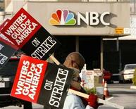 <p>Members of the Writers Guild of America carry picket signs as the strike against television and film producers continues, at an entrance to the NBC television network studios in Burbank, California January 8, 2008. The head of the Motion Picture Association of America said on Saturday a recent labor contract between major studios and film and TV directors offers a template for deals with striking writers and other guilds. REUTERS/Fred Prouser</p>