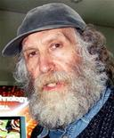 <p>In this file photo former world chess champion Bobby Fischer departs for Iceland from Narita international airport in Narita, northeast of Tokyo following his release from detention March 24, 2005. Fischer, who died in Iceland last week aged 64, was buried on Monday in a private ceremony near the city that hosted his famous victory over the Soviet Union's Boris Spassky 35 years ago. REUTERS/Yuriko Nakao</p>