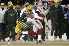 "<p>New York Giants cornerback Corey Webster intercepts a pass to Green Bay Packers Donald Driver (R) in over-time to set up a game winning field goal to win the NFL's NFC Championship football game in Green Bay, Wisconsin January 20, 2008. The NFC Championship Game, which aired Sunday on Fox, was the most-watched non-Super Bowl program on TV since the ""Seinfeld"" finale in 1998. REUTERS/John Gress</p>"