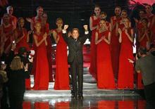 <p>Italian designer Valentino stands with his models and waves at the end of his final Spring/Summer 2008 Haute Couture fashion collection in Paris January 23, 2008. REUTERS/Benoit Tessier</p>