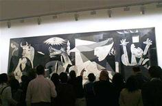"<p>Visitors look at Spanish artist Pablo Picasso's masterpiece ""Guernica,"" at Madrid's Reina Sofia museum April 25, 2007. The Reina Sofia museum is about to open one of the most extensive Picasso exhibitions as it hosts works on loan from the National Picasso Museum in Paris to add to those already on view in the Spanish capital. REUTERS/Susana Vera</p>"