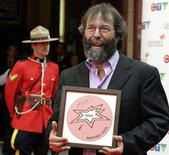 <p>Promoter Michael Cohl holds his plaque at a Canada Walk of Fame induction ceremony in Toronto, June 5, 2005. Touring and promotion company Live Nation Inc said on Monday it has elected Cohl as chairman of its board, effective immediately. REUTERS/Mike Cassese MC</p>