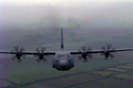 A Lockheed Martin C130J Hercules transport plane is seen coming in to land at RAF Lyneham, in this file photo. REUTERS/HO Old