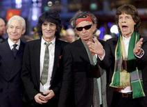 <p>Rolling Stones members Charlie Watts, Ron Wood, Keith Richards and Mick Jagger pose at the red carpet as they arrive for the screening of the opening film 'Shine A Light' running in competition at the 58th Berlinale International Film Festival in Berlin February 7, 2008. REUTERS/Hannibal Hanschke</p>